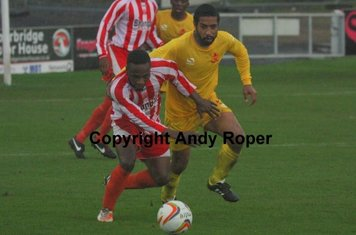Holding off the Banbury centre half.....