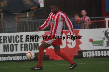 Stourbridge newcomer Kayelden Brown on the ball.....