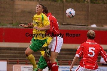 Rowey flicks the ball on.....