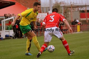 The Stourbridge wide man passes the ball to a team mate.....