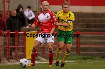 Sean forces Workington's Phil McLackie to play the ball backwards.....
