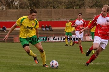 Will challenges Dan Wordsworth in the home penalty area.....