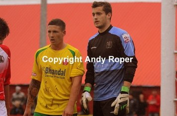 Rowey waits for a Geddes corner, marshaled by home 'keeper Alex Wimmer.....
