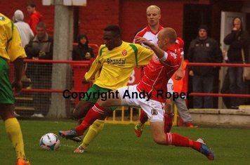 Roly gets in his cross, despite the attentions of right back Lee Andrews.....