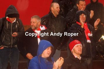 """""""Stourbridge 'till we dry""""; the hardy fans behind the goal support their team to the soaking wet end!"""