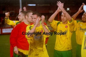 The players acknowledge the support of the fans.....