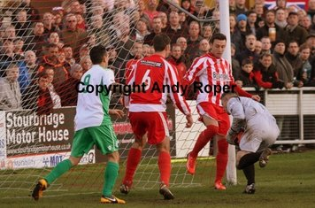 Nathan and Drew cover Dean after a visitor's attack on the Stourbridge goal.....