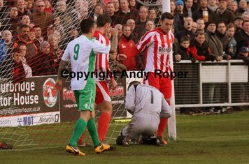 Nathan and Dean keep Sam reed away from the ball.....