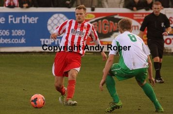 Leon looks for the pass ahead of Evan Key.....