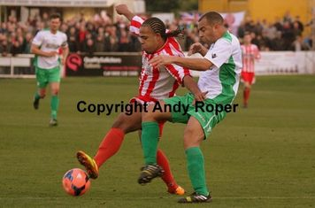 The Glassboys front man comes under pressure from the Town forward.....