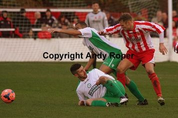 Leon does battle with Lee Allinson (on the ground) and Callum Lewis.....