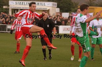 Drew fires another shot off at the Town goal.....