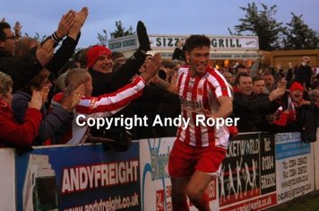 .....and celebrates with the fans at the clock end.