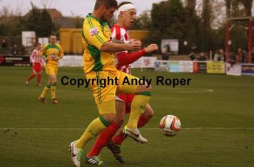 Ben battles for the ball with Nathan Peat.....