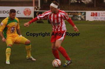 Closed down by United defender Nathan Peat.....