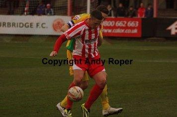 The Glassboys striker brings the ball down.....
