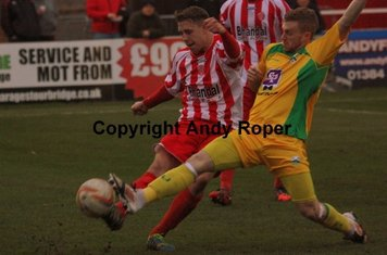 Ben battles for the ball with Jamie Yates.....