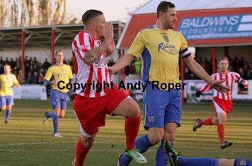 Rowey sidesteps the oncoming Weymouth 'keeper Jason Matthews.....