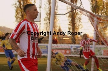 Rowey contemplates his goal whilst Luke celebrates in the background.....