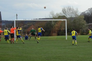 Finney and Scott wait to head the ball