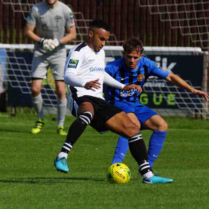 Dean Grant looks to turn the defender