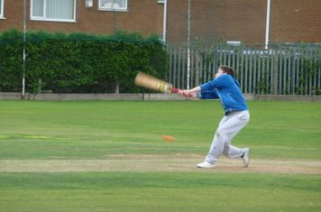 James Emmott struggles to keep hold of his bat after a wild swing.