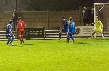 ...and George Moore flicks the ball into the net