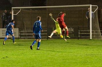Ryan Moss flicks the ball to the far post...