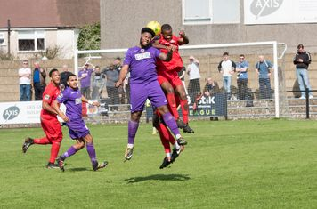 Two Borough defenders challenge Omar Folkes
