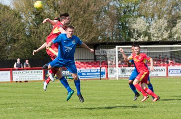 Adam Richards and George Moore make it hard for Jamie Griffiths