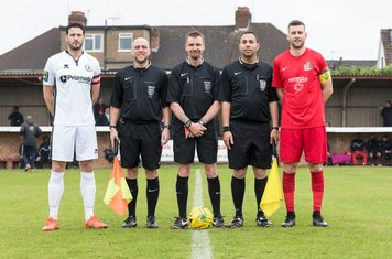 Captains Gary Elphick and Mark McLeod and the Officials