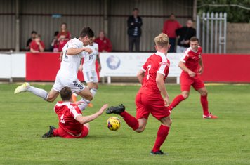 George Fenton tries to halt another Tiverton attack