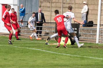 Hafed Al-Droubi smothers a low Tiverton cross