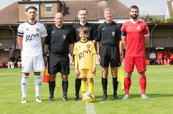 Referee Paul Johnson, his Assistants, Captains Jamie Price and Ryan Moss, and the Tiverton mascot