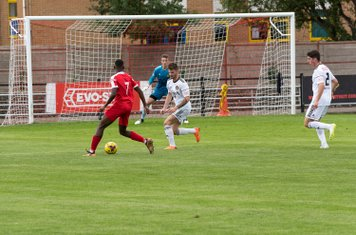 Frank Keita threatens the Tiverton goal...