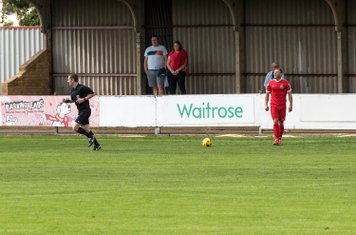 George Moore takes a free kick...