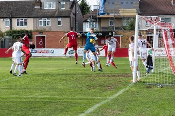 ...Liam Armstrong fumbles the cross under pressure from Anthony O'Connor...