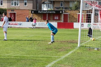 ...whose shot leaves the Tiverton defence flat-footed