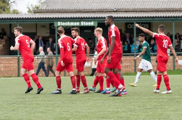 The team celebrates with Lewis Cole