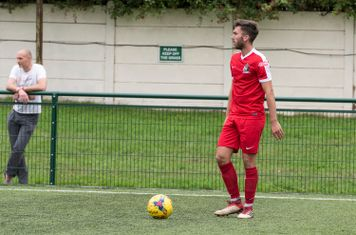 Lewis Cole takes a free kick after he is fouled...
