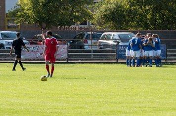 ...the Salisbury players go into a huddle...