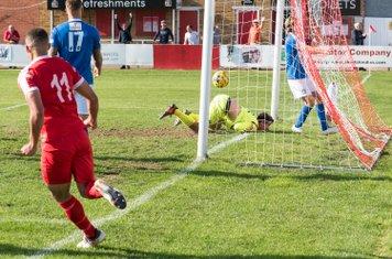...to volley past Jake Hallett