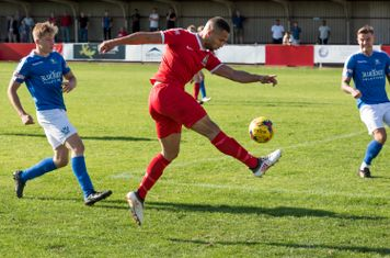 Anthony O'Connor receives the ball from Ryan Moss, goes forward, and plays the ball square...