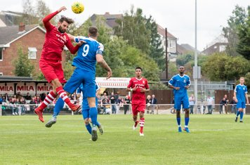 The Hornchurch defence clears another of Harrow's long balls