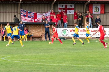 George Moore goes forward in front of a rather small contingent of Borough supporters