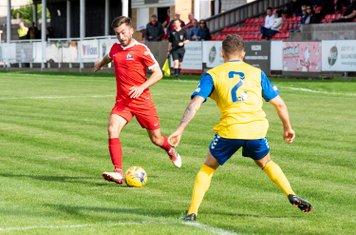 Lewis Cole tries to get past Thomas Leggett