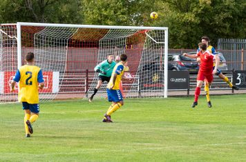 George Fenton heads for goal...