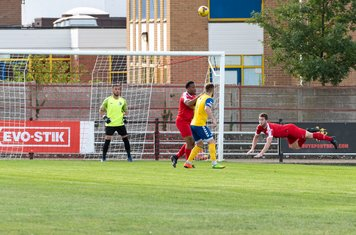 George Fenton with an acrobatic clearance