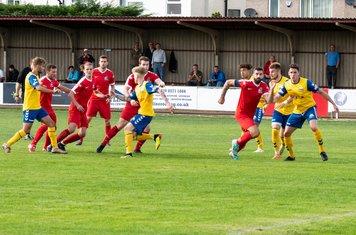...Borough preare to attack the ball...