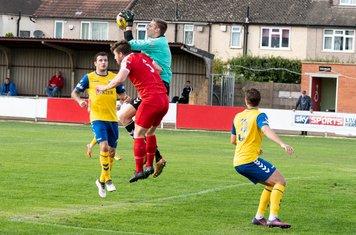 Patrick O'Flaherty takes the ball off George Fenton's head